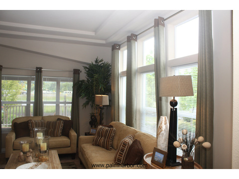 Living room well lit with natural lighting - The Mt. Shasta 5V465A4, Palm Harbor Homes