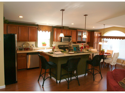 Spacious kitchen features island with breakfast bar and lots of cabinet space - The Mt. Shasta 5V465A4, Palm Harbor Homes