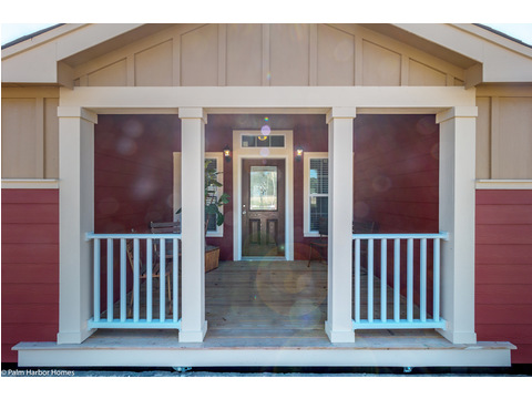 This built-in porch provides cover from the sun and the rain for your guests and provides a gracious entrance to your home - the Hacienda by Palm Harbor Homes - 4 Bedrooms, 3 Baths, 2338 Sq. Ft.