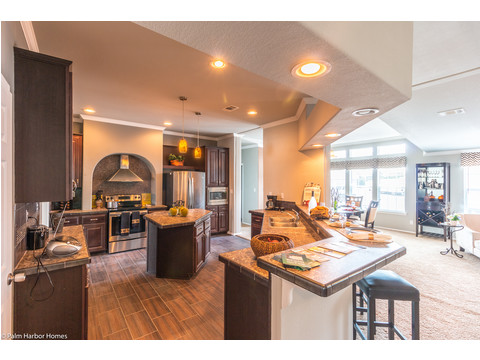 This is a great example of our Center-of-the-universe kitchen that makes the kitchen the hub of the living area, seen here in The Hacienda SCWD60T5 by Palm Harbor Homes