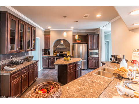 The island provides extra space for prep work in the kitchen of our Hacienda SCWD60T5 by Palm Harbor Homes