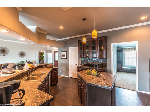 "The kitchen includes a Built-in buffet with 42"" overhead Durabuilt Cabinets in The Hacienda SCWD60T5 by Palm Harbor Homes"