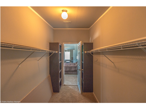 Lots and lots and lots of room for both of you in this master closet in the Hacienda by Palm Harbor Homes - 4 Bedrooms, 3 Baths, 2338 Sq. Ft.