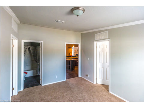 The play room has an attached restroom and access to the kitchen and two secondary bedrooms in the Hacienda manufactured home by Palm Harbor Homes - 4 Bedrooms, 3 Baths, 2338 Sq. Ft.