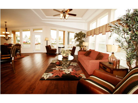 Living room featuring optional tower dormer - The Metolius Cabin N5P264K1, Palm Harbor Homes