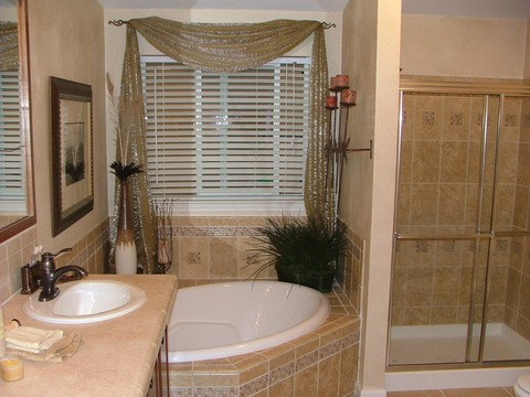 Glamour bathroom treatment with hand laid tile shower and tub pedestal - The Metolius Cabin N5P264K1, Palm Harbor Homes