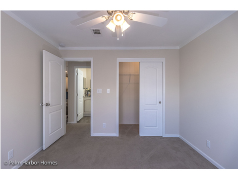 Guest bedroom with walk-in closet - Buena Vista by Palm Harbor Homes, 2 Bedrooms, 2 Baths, 1,109 Sq. Ft.