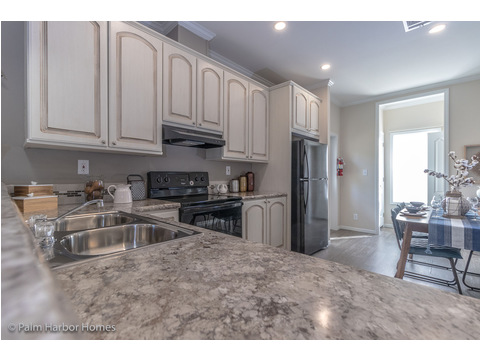 Cozy kitchen to the Buena Vista #manufacturedhome by Palm Harbor Homes - 2 Bedrooms, 2 Baths, 1,109 Sq. Ft. - Porch included