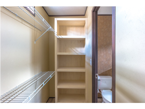 Lots of storage in the master closet in the Model 16763R single wide manufactured home with 3 Bedrooms, 2 Baths, 1,185 Sq. Ft. available from Palm Harbor Homes