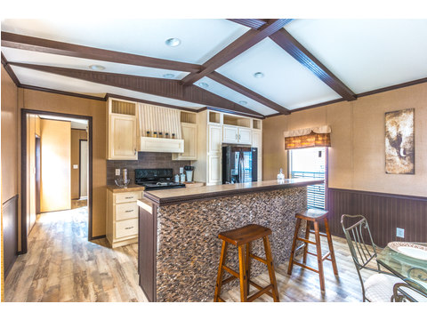Elevated bar area is great for breakfast, lunch, dinner - - or homework!   Model 16763R single wide manufactured home with 3 Bedrooms, 2 Baths, 1,185 Sq. Ft. available from Palm Harbor Homes