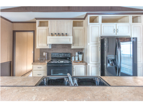 Light, bright and up-to-date cabinetry in the  Model 16763R single wide manufactured home with 3 Bedrooms, 2 Baths, 1,185 Sq. Ft. available from Palm Harbor Homes