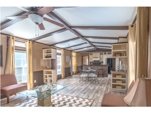 Gorgeous, wide-open living area with clear site lines. Model 16763R single wide manufactured home with 3 Bedrooms, 2 Baths, 1,185 Sq. Ft. available from Palm Harbor Homes