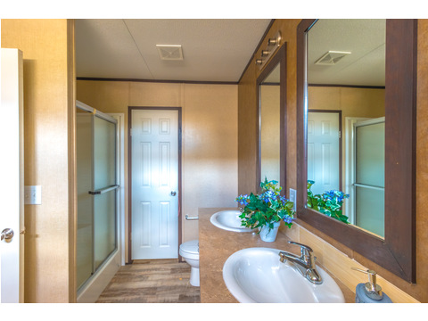 Master bath features large walk-in shower in the Model 16763R single wide manufactured home with 3 Bedrooms, 2 Baths, 1,185 Sq. Ft. available from Palm Harbor Homes