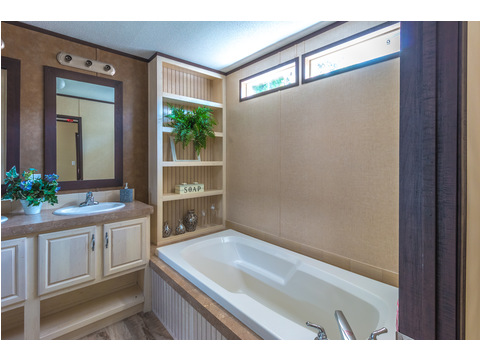Gorgeous master bath with lots of built-ins in the Model 16763R single wide manufactured home with 3 Bedrooms, 2 Baths, 1,185 Sq. Ft. available from Palm Harbor Homes
