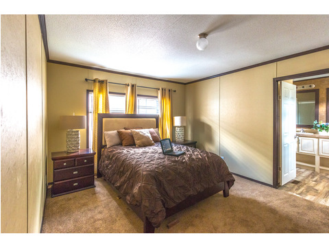 Roomy master bedroom with on suite master bath in the Model 16763R single wide manufactured home with 3 Bedrooms, 2 Baths, 1,185 Sq. Ft. available from Palm Harbor Homes