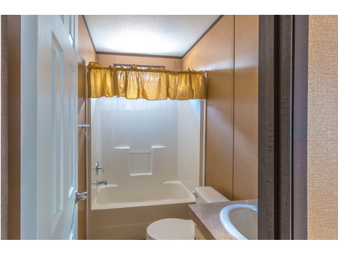 Nicely appointed secondary bath in Model 16763R single wide manufactured home with 3 Bedrooms, 2 Baths, 1,185 Sq. Ft. available from Palm Harbor Homes - click AVAILABILITY tab to find this home near you