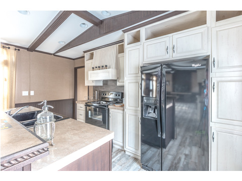 Check out the Whirlpool appliances shown here in stunning stainless steel!   Model 16763R single wide manufactured home with 3 Bedrooms, 2 Baths, 1,185 Sq. Ft. available from Palm Harbor Homes