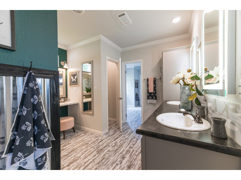 Master suite with large walk-in closet and 6-foot shower in the Vintage Farmhouse Model FT32643C with 3 Bedrooms, 2 Baths and 1,984 Sq. Ft. Exterior Dimensions: 31 x 64. Other layouts available from Palm Harbor Homes.  Austin TX