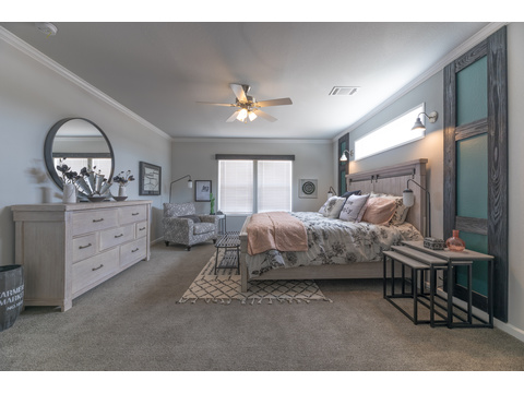 Master bedroom in the Vintage Farmhouse Model FT32643C with 3 Bedrooms, 2 Baths and 1,984 Sq. Ft. Exterior Dimensions: 31 x 64. Other layouts available from Palm Harbor Homes. Austin TX