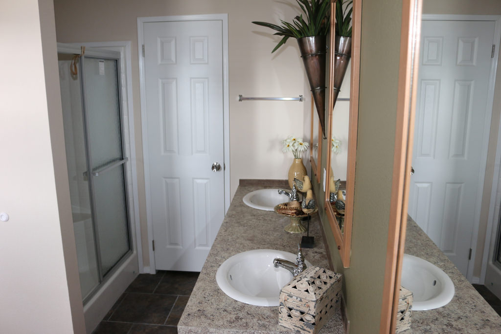 The grand cypress ff18763b manufactured home floor plan or modular floor plans for Showers for mobile homes bathrooms