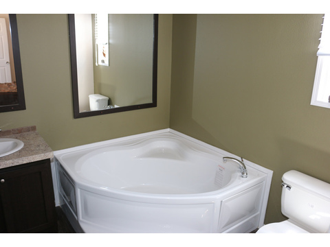 Soak your day away in this massive tub in the  Grand Cypress manufactured home featuring 3 Bedrooms, 2 Baths, 1178 Sq. Ft. - www.palmharbor.com