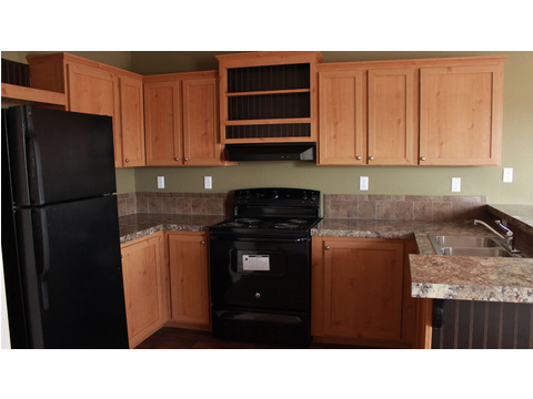 The full-sized kitchen on the Hibiscus manufactured home is fully-stocked with full sized appliances - ready to move in! Got a deer lease?  This home is easy to relocate if you change leases!