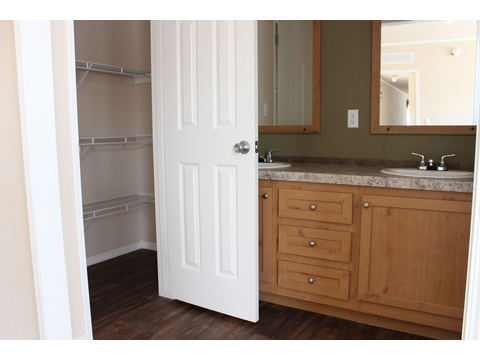 Speaking of storage, this handy linen closet provides lots of it! Towels, sheet sets, shampoo, soap, make-up - even off season clothes are right at your fingertips in the Hibiscus. Note the nice doors! They give the room more dimension.