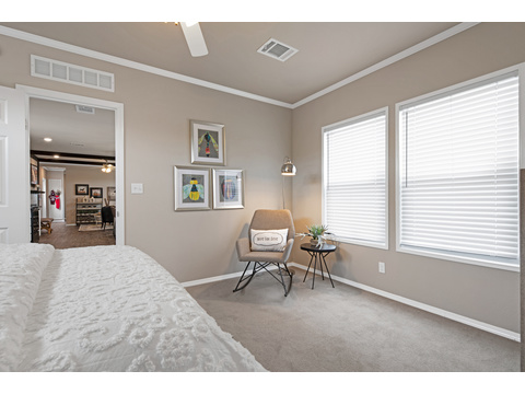 "Master bedroom in The Lago Mira Model FF16763I - 3 Bedrooms, 2 Baths, 1,130 Sq. Ft.- By Palm Harbor Homes. This home available only in Oklahoma and Texas. Exterior Dimensions: 15'6""x76'"