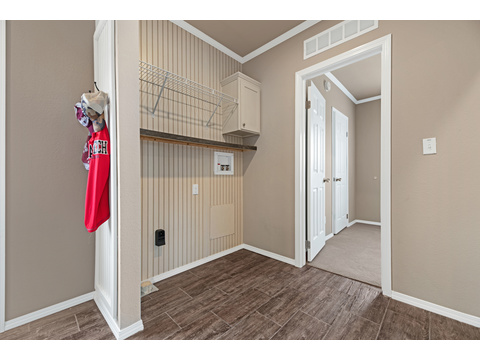 "Laundry room in The Lago Mira Model FF16763I - 3 Bedrooms, 2 Baths, 1,130 Sq. Ft.- By Palm Harbor Homes. This home available only in Oklahoma and Texas. Exterior Dimensions: 15'6""x76'"