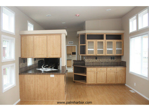 The Avanti III by Palm Harbor Homes - Extensive woodwork in kitchen.