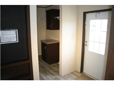 The back door has easy access to the utility room with washer and drier and more and the mud room with a place to sit and remove shoes and the kitchen for a snack with mom and dad.
