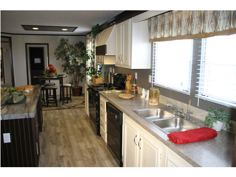 We love the kitchen in the 28603A model at Palm Harbor Homes - a 1600 square foot manufactured home with 3 bedrooms and 2 bathrooms and much more! www.palmharbor.com