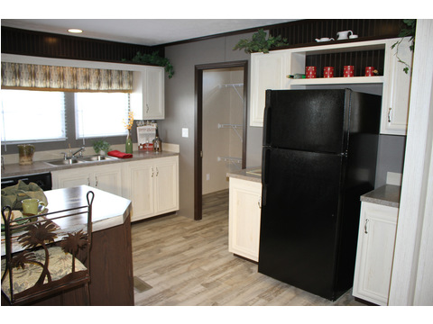 Lots of extra storage and country space around the refrigerator in the kitchen in the 28603A model at Palm Harbor Homes - a 1600 square foot manufactured home with 3 bedrooms and 2 bathrooms and much more! www.palmharbor.com
