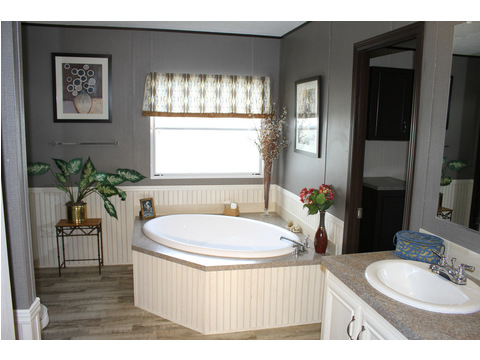 You can definitely soak your cares away in this beautiful, large tub. Love the wainscoting in this master bath!