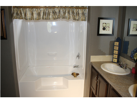 This guest bath also features a large, step-in tub with a sleek, easy to clean surround to reduce time spent cleaning and to help prevent costly water leaks and damage.