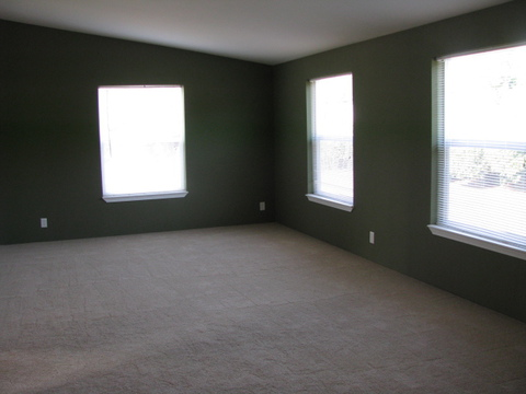The Living Room in the Mountain View III manufactured home with 3 Bedrooms, 2 Baths, 1908 Sq. Ft.