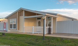 Side view of The Summer Breeze IV double wide manufactured home by Palm Harbor Homes in Florida - 2 Bedrooms, 2 Baths, 1,279 Sq. Ft. and 120 square foot built in front porch. Exterior Dimensions: 52'x26'8