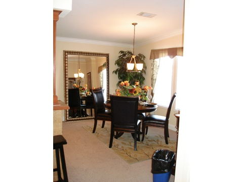 Dining Room with large windows at front of home - Cumberland P3466A by Palm Harbor Homes
