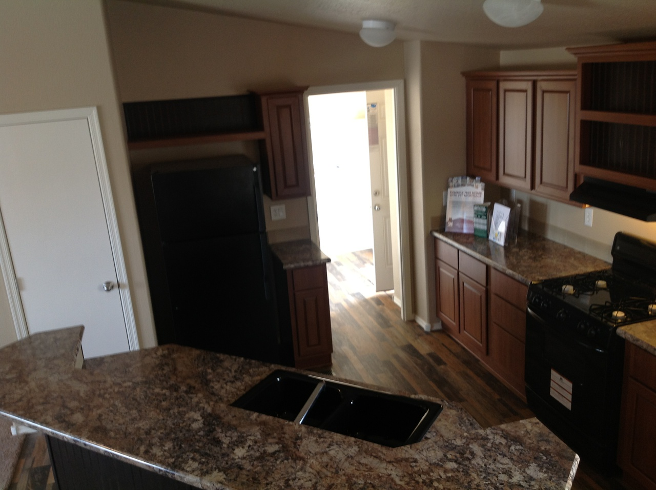 View the durango floor plan for a 1173 sq ft palm harbor for Efficient kitchen layout