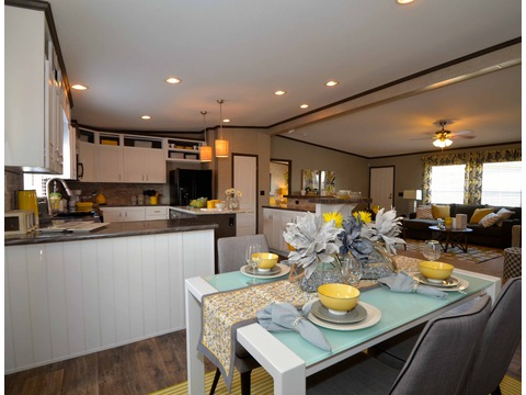 The dining area overlooks the kitchen and living area - The Benbrook KHT364F2 by Palm Harbor Homes