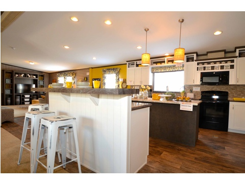 Island kitchen with bar stools makes for a great breakfast nook - The Benbrook KHT364F2 by Palm Harbor Homes