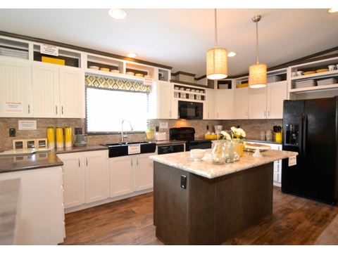 A picture can't capture the real essence of this kitchen nor can it capture how many cabinets are in it :)  - The Benbrook KHT364F2 by Palm Harbor Homes