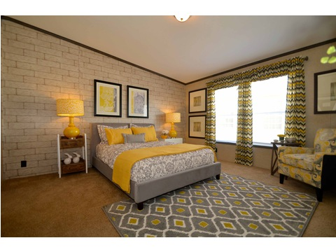 Very spacious master bedroom suite that can accommodate any size bed and accompanying furniture - The Benbrook KHT364F2 by Palm Harbor Homes