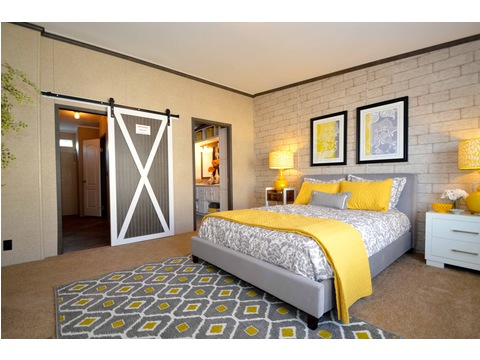 "Huge walk in closet in the master bathroom with an added spot light feature - an optional sliding ""barn door""! Ask your Palm Harbor housing specialist about this unique feature."
