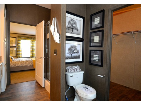 The Benbrook misses no opportunities for convenient storage - - even in the bath! This commode surround provides additional storage for toilet paper, reading material and linens.