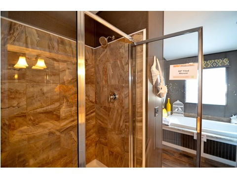Large walk in shower in the rear of the master bathroom
