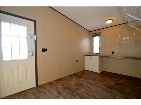 The utility room also very spacious - check out the folding table and other features in this great bonus space - The Benbrook KHT364F2 by Palm Harbor Homes