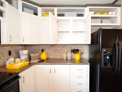 This Benbrook manufactured home by Palm Harbor Homes has fabulous kitchen cabinetry for storage galore! And the stone back splash is as beautiful as it is protective for your walls.