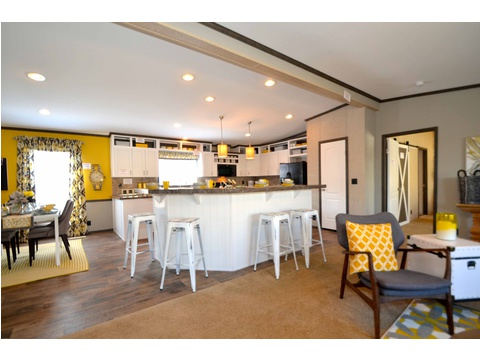 Very open spacious living area is adjacent to both the kitchen and dining area for maximum family time together :) - The Benbrook KHT364F2 by Palm Harbor Homes