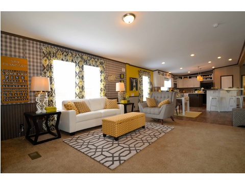 The family area is just off the kitchen and dining area, but within a close proximity of mom in the kitchen so she is part of the family.  Palm Harbor Homes - Benbrook - 3 bedroom, 2 bath - there is a 4 bedroom version as well.